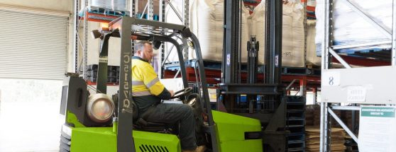 Sadleirs employee operating forklift in warehouse