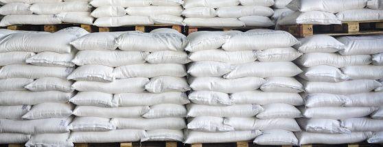 Pallet stacks of waterproof PE bags in warehouse