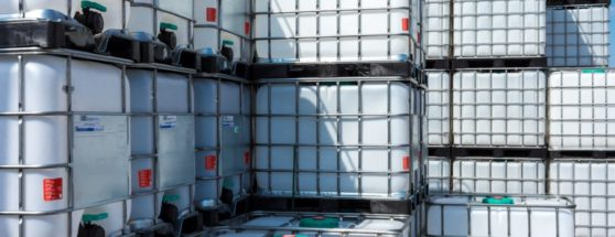 stacked IBC Containers in depot