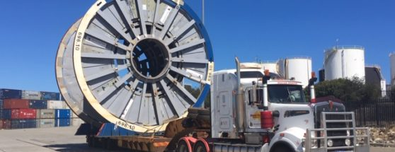 Oversized wheel freight transported by truck