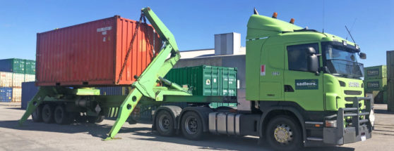 Sadleirs side loader handling shipping container freight in depot